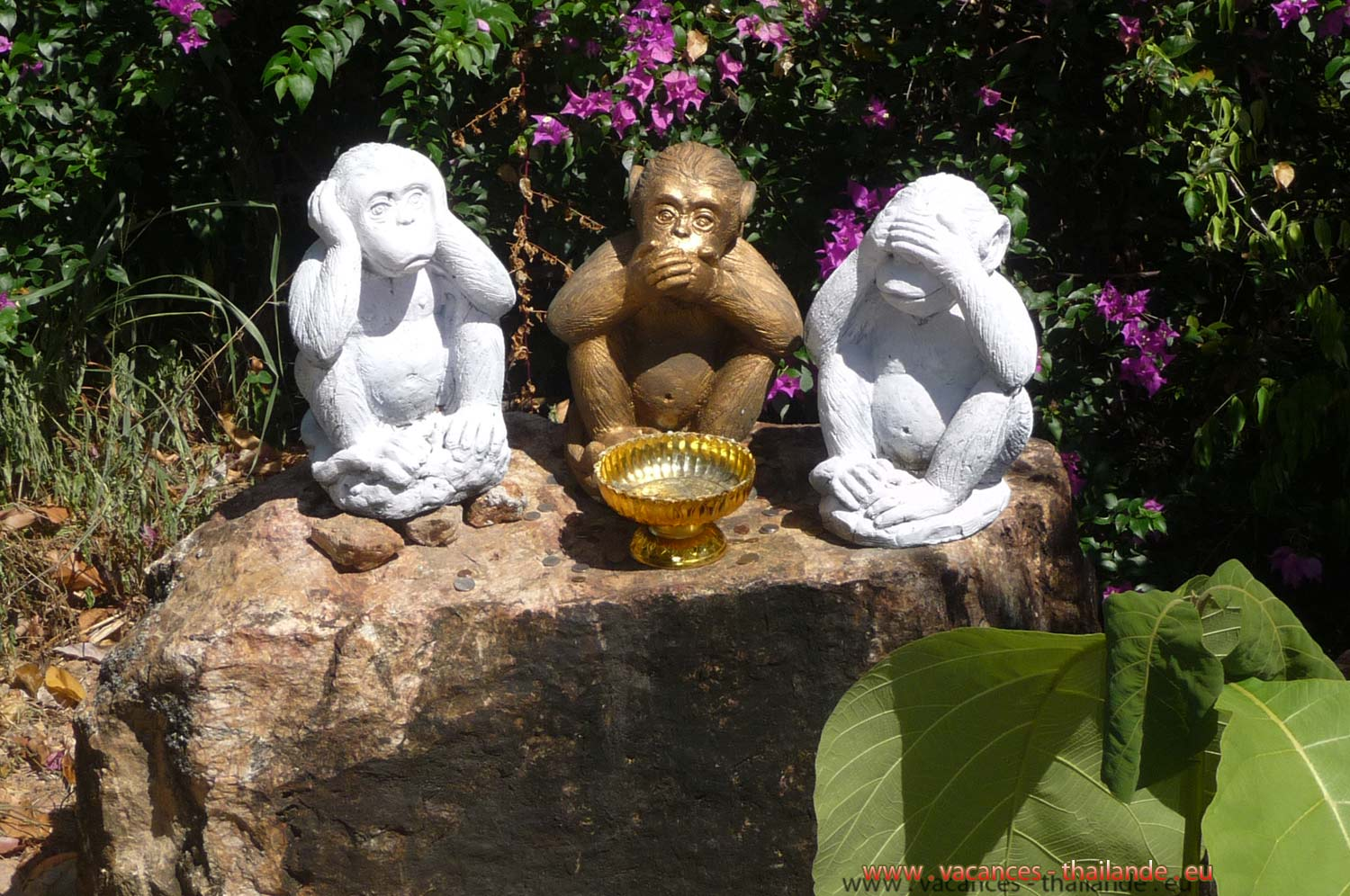 hree wise monkeys in very beautiful Buddhist temples in Thailand